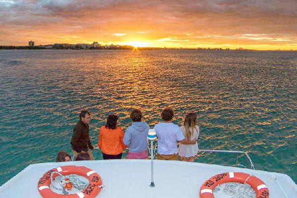 people on a boat looking at a Sunset on Mooloolaba Sunset Cruise Sunshine Coast